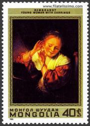 Mujer joven con pendientes. Rembrandt